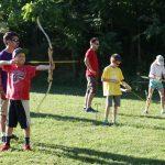 Kids practicing archery.