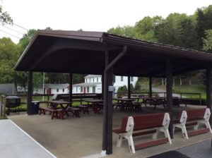 Pavilion with picnic tables and benches.